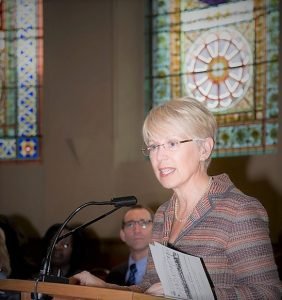 Image of Dr. Patty Rigby at podium, convocation awards ceremony, 2011