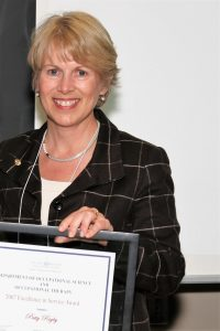 Image of Patty Rigby with 2007 Excellence in Service Award