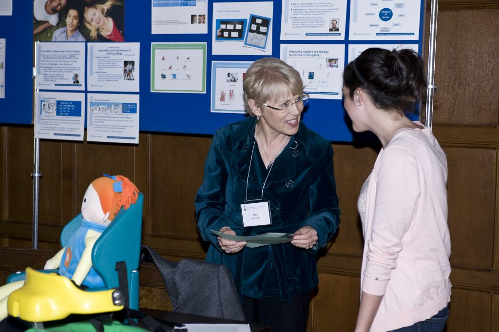 Image of Dr. Patty Rigby presenting research at event