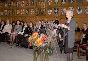 Image of Dr. Patty Rigby at podium, convocation 2010
